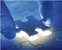 Hand picking up jigsaw piece